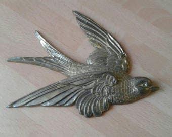 Vintage brass swallow or bluebird
