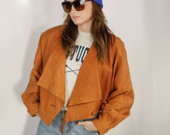 Size 8 -10 vintage 90s cropped brown leather jacket