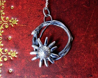 Handmade silver pendant of sterling silver organic circle with a sunflower