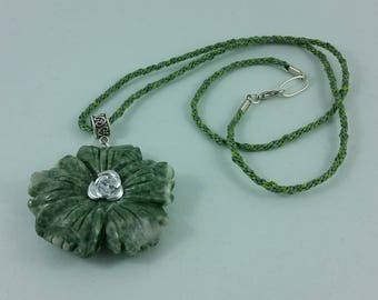Necklace: Flower of Green; green stone flower pendant on braided silk cord