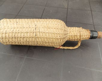 French wicker covered water / wine bottle.