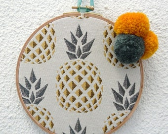 Decorative frame with tassels and pineapple