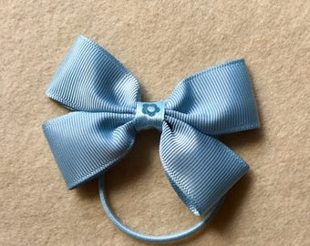 Pair of Ice blue bobble bow with flower detail