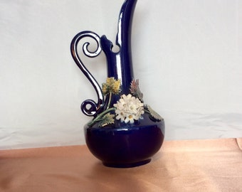 Blue wine or water decanter with flowers and leaves