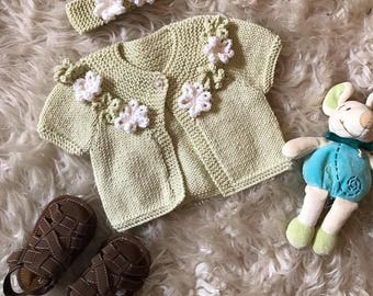 Baby's hand knitted baby cashmere cardigan and matching headband. Handmade knitted. Soft warm luxury sweater