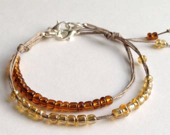 set of 2 bracelets of glass and silver amber yellow brown delicate hand made textile