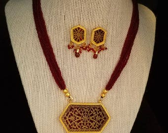 Jaipuri-style gold and red/blue/green necklace set with matching earrings