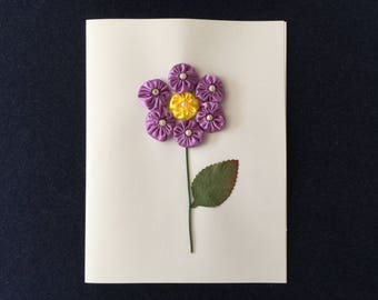 Greeting Card with a Purple Flower Design