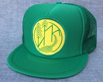 UNS Nature design. Trucker hat w/patch.