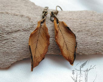 Slope of dry leaf. Original handmade leather pendant