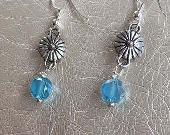 Turquoise  and silver dangle earrings with silver embellishment.