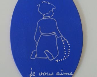 silhouette of a small child kneeling on an oval hand painted