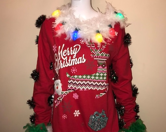 "Hand Made Merry Christmas  ""Ugly Christmas Sweater with 2 Strings of lights"" and lots of Trinkets in (Assorted Sizes) Limited Quantity"