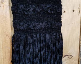 Hand woven wall hanging in black