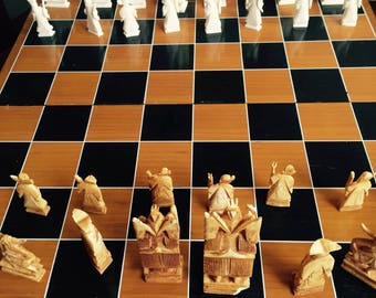 Folding chess set, hand carved pieces