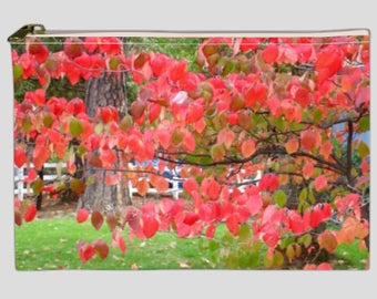 Pouch, clutch, makeup bag with photo of fall leaves printed  on both sides, zippered top.