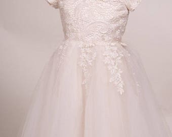 Pure Elegant sleeve laced Ivory white flower girl dress with gorgeous Satin buttons.