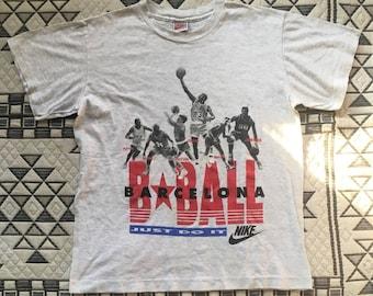 "90s NIKE Gray Tag B Ball Barcelona ""Just Do It"" T-Shirt"