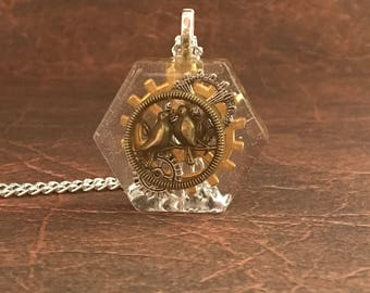 Steampunk Pendant , hexagon resin , gear wheel and bird charms