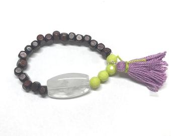 Lime, purple, and wood bead bracelet