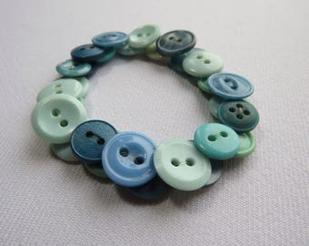 Teal/green/turquoise upcycled button bracelet