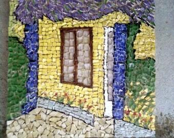 the Wisteria running along a village house facade.