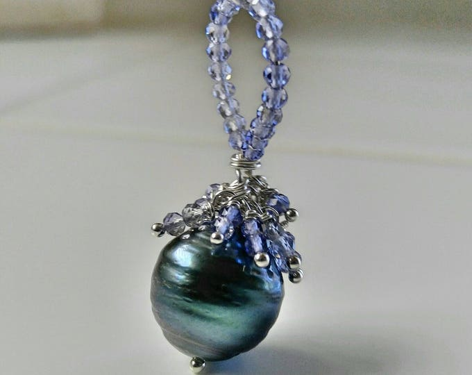 Large black Tahitian pearl and Tanzanite necklace. Silvery black pearl clustered with Tanzanite gemstones on a sterling silver chain for her
