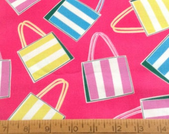 Tossed beach bags on pink background cotton fabric by the yard