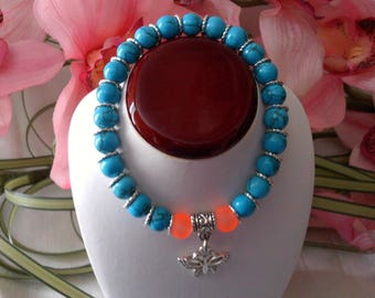 Turquoise Glass Beaded Bracelet Accented with A Butterfly Charm