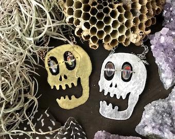 Hammered metal laughing skulls