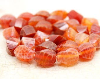 Red Fire Agate Faceted Twisted Puffed Oval Beads