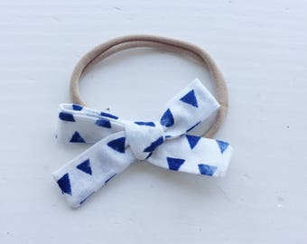 Emma Bow on headband - white with blue triangles