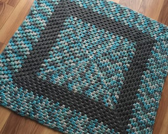 Multicolor blue with tan crochet afghan