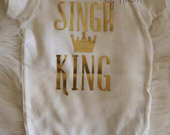 Singh is King baby onesie