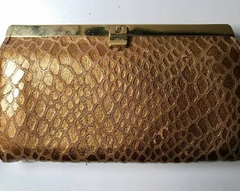 Abas gold clutch