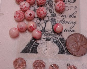 Peachy-keen bead lot. Mixed lot of peachy colored beads. Rose blooms..faceted crystals and marblized beads.18 on all.