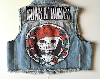 Distressed Denim vest, cropped, w/ Guns & Roses Band emblem on back.