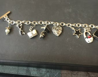 Silver and black charm bracelet
