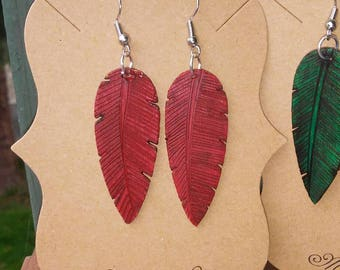 Red and green holiday wooden feather earrings