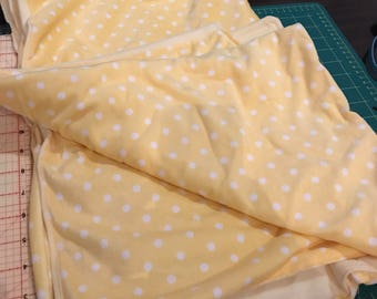 Stroller blanket and burp cloth. Flanellette and fleece Yellow with white spots