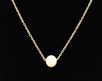 Single White Floating Pearl Necklace on Gold Necklace