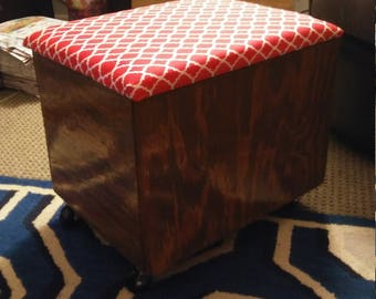 Cushioned storage ottoman with casters