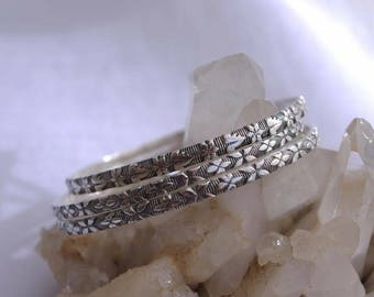 Set of 3 sterling silver textured wire bangles. Custom sizing available.