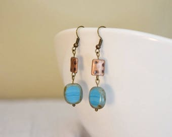 Antiqued copper and blue glass dangle earrings
