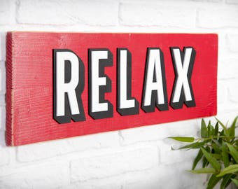 Poster of recycled wood with relief - Relax - lyrics