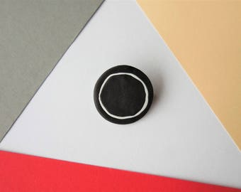 Minimalistic and modern round black brooche with white circle, handmade of clay and unique
