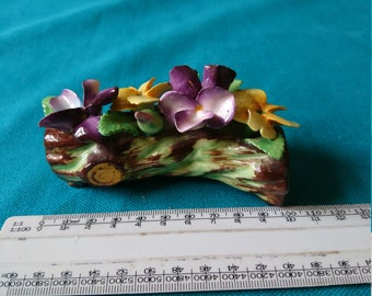 Vintage China pansies on log.