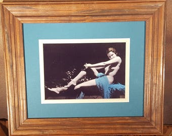 "REPRODUCTION:  Hand-tinted pin-up of a nude woman, c.1920, image size 5"" x 7"", matted in gold and teal, mounted in modern wood frame"
