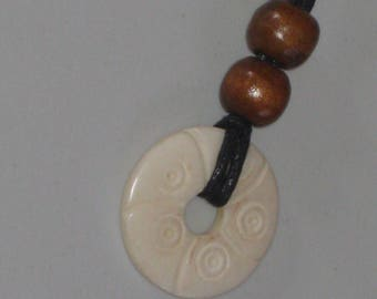 Hand carved bone pendant, with adjustable necklace.