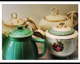 Four teapots